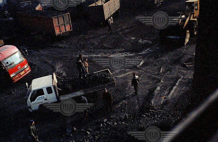 Workers loading a truck at a coal mine just outside Linfen.