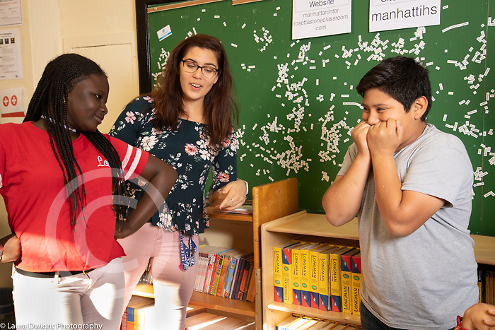 Education High School drama elective female coach working with students