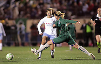 Marian Dalmy (white) passes the ball pass the out streched Sara Larsson..Saint Louis Athletica were defeated 1-0 by Chicago Red Stars.