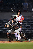 San Antonio Missions catcher Austin Hedges (15) checks a runner in front of Vance Albitz (23) during a game against the Arkansas Travelers on May 24, 2014 at Dickey-Stephens Park in Little Rock, Arkansas.  Arkansas defeated San Antonio 4-2.  (Mike Janes/Four Seam Images)