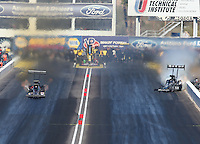 Feb. 24, 2013; Chandler, AZ, USA; NHRA top fuel dragster driver Shawn Langdon (right) loses traction as Leah Pruett gets her first round win during the Arizona Nationals at Firebird International Raceway. Mandatory Credit: Mark J. Rebilas-