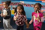 Education Preschool group of girls pretend play singing using blocks as microphones
