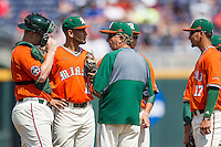 Miami Hurricanes head coach Jim Morris visits the mound during of the NCAA College World Series against the UC Santa Barbara Gauchos in Game 5 on June 20, 2016 at TD Ameritrade Park in Omaha, Nebraska. UC Santa Barbara defeated Miami  5-3. (Andrew Woolley/Four Seam Images)