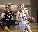 SIOUX FALLS, SD - MARCH 6: Lindsey Theuninck #3 of the South Dakota State Jackrabbits drives past Sophie Johnston #42 of the Omaha Mavericks during the Summit League Basketball Tournament at the Sanford Pentagon in Sioux Falls, SD. (Photo by Richard Carlson/Inertia)
