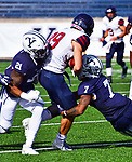 October 26th 2019: Ryan Rouse [7] puts the hit on Ryan Cragun [89] as the Bulldogs up their record to 5-1 defeating the Quakers of Penn 46-41.  The Ivy League match up was at the Yale bowl in New Haven, Connecticut.  Dan Heary/ESW/CSM