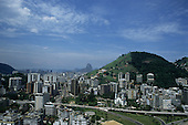 Rio de Janeiro, Brazil. Downtown high rise buildings with a colonial church and the Sugar Loaf in the distance.