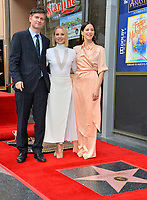 LOS ANGELES, CA. November 19, 2019: Kristen Bell, Michael Schur & Jackie Tohn at the Hollywood Walk of Fame Star Ceremony honoring Kristen Bell & Idina Menzel.<br /> Pictures: Paul Smith/Featureflash