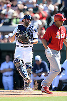 Detroit Tigers catcher Alex Avila (13) jokingly kicks dirt at former teammate Jhonny Peralta (27) after a home run during a spring training game against the St. Louis Cardinals on March 3, 2014 at Joker Marchant Stadium in Lakeland, Florida.  Detroit defeated St. Louis 8-5.  (Mike Janes/Four Seam Images)