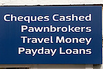 Payday Loans, Pawnbrokers Cheques Cashed, Travel Money, High Street sign . Staines Middlesex UK 2012 2010s