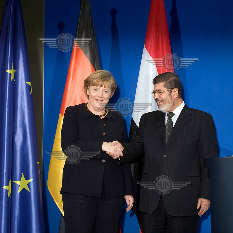DEU, Deutschland, Germany, Berlin, 30.01.2013.German Chancellor Angela Merkel and Egyptian President Mohamed Mursi during a press conference at the Chancellery in Berlin, Germany. Mursi has come to Berlin despite the ongoing violent protests in recent days in cities across Egypt. Mursi is in Berlin to seek both political and financial support from Germany. International Politics, Germany, Europe, Politican, 2013..