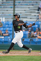 Franklin Reyes (13) of the Great Falls Voyagers follows through on his swing against the Helena Brewers at Centene Stadium on August 19, 2017 in Helena, Montana.  The Voyagers defeated the Brewers 8-7.  (Brian Westerholt/Four Seam Images)