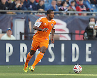 Houston Dynamo defender Jermaine Taylor (4) looks to pass. In a Major League Soccer (MLS) match, the New England Revolution (blue/white) defeated Houston Dynamo (orange), 2-0, at Gillette Stadium on April 12, 2014.