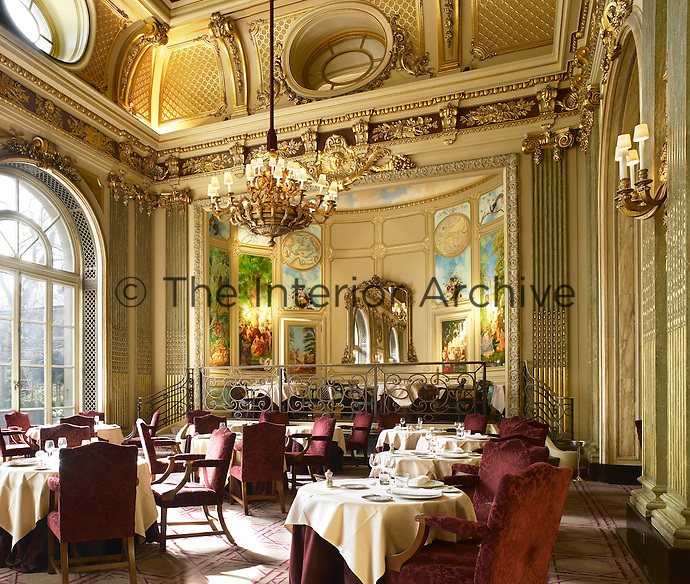 The interior of the London's Royal Automobile Club. The Great Gallery restaurant. Robert Carter's updates include the hand-blocked wood floor, the design of which was inspired by Pavlovsk Palace in St. Petersburg, Russia. At the dining room's far end is the Minstrels Gallery, an elevated private area for 12 featuring a series of murals by Catherine Lovegrove.