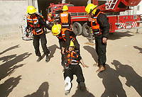 """Hamas-led civil emergency workers carry out a drill on extinguishing a fire in Gaza December 27, 2007.<br />  (photo by Fady Adwan"""""""