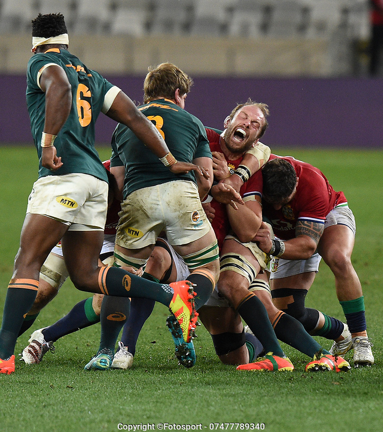 Alun Wyn Jones - British & Irish Lions captain grimaces in pain as he is tackled by Kwagga Smith and Franco Mostert - South Africa.<br /> South Africa v British & Irish Lions, 1st Test, Cape Town Stadium, Cape Town, South Africa,  Saturday 24th July 2021. <br /> Please credit: FOTOSPORT/DAVID GIBSON