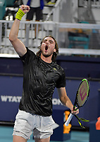 MIAMI GARDENS, FL - MARCH 29: (NO SALES TO NEW YORK POST) Stefanos Tsitsipas of Greece defeats Kei Nishikori of Japan on day 8 of the Miami Open on March 29, 2021 at Hard Rock Stadium in Miami Gardens, Florida<br /> <br /> <br /> People:  Stefanos Tsitsipas