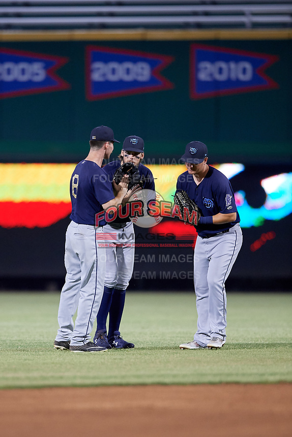 Mobile BayBears outfielders Brandon Sandoval (8), Brandon Marsh (9), and Brendon Sanger (4) celebrate after closing out a Southern League game against the Jacksonville Jumbo Shrimp on May 28, 2019 at Baseball Grounds of Jacksonville in Jacksonville, Florida.  Mobile defeated Jacksonville 2-1.  (Mike Janes/Four Seam Images)