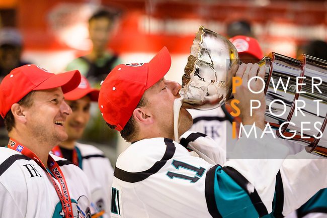 Hal Slominski of Cathay Flyers (R) celebrates with the champion's trophy during the Mega Ice Hockey 5s International Elite Final match between Nordic Vikings and Cathay Flyers on May 05, 2018 in Hong Kong, Hong Kong. Photo by Marcio Rodrigo Machado / Power Sport Images