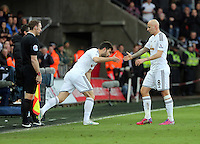 SWANSEA, WALES - FEBRUARY 21: Jonjo Shelvey of Swansea is substituted by Jordi Amat during the Barclays Premier League match between Swansea City and Manchester United at Liberty Stadium on February 21, 2015 in Swansea, Wales.