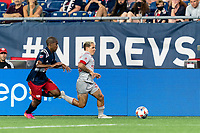 FOXBOROUGH, MA - JULY 7: Yeferson Soteldo #30 of Toronto FC brings the ball forward as Maciel #13 of New England Revolution closes during a game between Toronto FC and New England Revolution at Gillette Stadium on July 7, 2021 in Foxborough, Massachusetts.