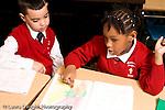 Parochial School Bronx New York  Kindergarten boy and girl talking about assignment horizontal