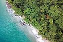 Lowland rainforest meets the sea (Indian Ocean). Masoala Peninsula / Bay of Antongil, north east Madagascar.
