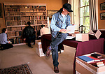 Country House Auction at Newnham Hall Northamptonshire 1994. Chritsies auction 1990s UK. NORTHAMPTONSHIRE ANTIQUARIAN BOOKSELLER CHECKING THE LOTS TALLY WITH CATALOGUE,