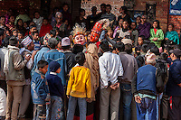 Bhaktapur, Nepal.  People Surrounding Masked Figures Representing Hindu Deities in Durbar Square.