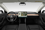 Stock photo of straight dashboard view of a 2019 Tesla Model-3 Performance 4 Door Sedan