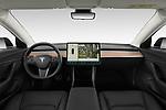 Stock photo of straight dashboard view of a 2019 Tesla Model-3 Performance 4 Door Sedan