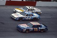 HAMPTON, GA - NOV 3:  Tommy Ellis, #18 Chevrolet, Terry Labonte, #44 Chevrolet and Lake Speed, #75 Pontiac, race through a turn during the Atlanta Journal 500 NASCAR Winston Cup race at Atlanta Motor Speedway, November 3, 1985. (Photo by Brian Cleary/www.bcpix.com)