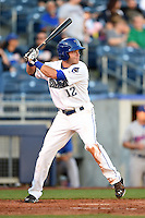 Tulsa Drillers second baseman Taylor Featherston (12) at bat during a game against the Midland RockHounds on May 31, 2014 at ONEOK Field in Tulsa, Oklahoma.  Tulsa defeated Midland 5-3.  (Mike Janes/Four Seam Images)