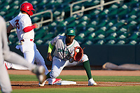 Daytona Tortugas first baseman Michel Triana (18) stretches for a pickoff attempt throw as Carlos Soto (35) gets back to the bag during a game against the Palm Beach Cardinals on May 4, 2021 at Roger Dean Chevrolet Stadium in Jupiter, Florida.  (Mike Janes/Four Seam Images)