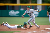 Dartmouth Big Green first baseman Michael Calamari (3) waits to receive a throw as Jake Sullivan (10) dives back to the bag during a game against the USF Bulls on March 17, 2019 at USF Baseball Stadium in Tampa, Florida.  USF defeated Dartmouth 4-1.  (Mike Janes/Four Seam Images)
