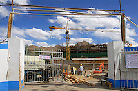 New construction in Lhasa reflects Chinese policy of westward expansion and industrialization of Tibet.  Han Chinese are encouraged to migrate to the Tibetan Plateau.