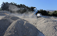 FAO JANET TOMLINSON, DAILY MAIL PICTURE DESK<br /> Pictured: A tipper lorry unloads soil to be searched by special forensics police officers in Kos, Greece. Monday 03 October 2016<br /> Re: Police teams led by South Yorkshire Police, searching for missing toddler Ben Needham on the Greek island of Kos have moved to a new area in the field they are searching.<br /> Ben, from Sheffield, was 21 months old when he disappeared on 24 July 1991 during a family holiday.<br /> Digging has begun at a new site after a fresh line of inquiry suggested he could have been crushed by a digger.