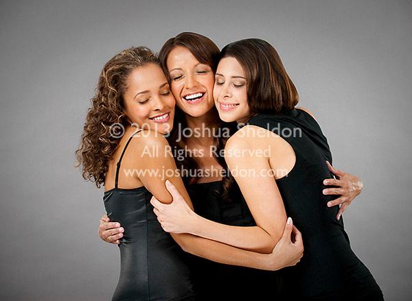 Group of Hispanic women embracing