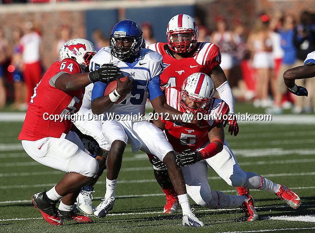 Southern Methodist Mustangs defensive tackle DARRIAN WRIGHT (54) and Southern Methodist Mustangs linebacker RANDALL JOYNER (5) tackle Memphis Tigers quarterback ERIC MATTHEWS (15) during the game between the Memphis Tigers and the Southern Methodist Mustangs at the Gerald J. Ford Stadium in Dallas, Texas. Memphis defeats SMU 48 to 3...