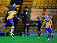 Lincoln City's Jamie Soule vies for possession with Mansfield Town's Rollin Menayese<br /> <br /> Photographer Andrew Vaughan/CameraSport<br /> <br /> EFL Trophy Northern Section Group E - Mansfield Town v Lincoln City - Tuesday 6th October 2020 - Field Mill - Mansfield  <br />  <br /> World Copyright © 2020 CameraSport. All rights reserved. 43 Linden Ave. Countesthorpe. Leicester. England. LE8 5PG - Tel: +44 (0) 116 277 4147 - admin@camerasport.com - www.camerasport.com