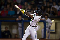 Hillsboro Hops first baseman Francis Martinez (23) follows through on his swing during a Northwest League game against the Salem-Keizer Volcanoes at Ron Tonkin Field on September 1, 2018 in Hillsboro, Oregon. The Salem-Keizer Volcanoes defeated the Hillsboro Hops by a score of 3-1. (Zachary Lucy/Four Seam Images)