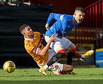 17.01.2021 Motherwell v Rangers: Jake Carroll goes through Ianis Hagi