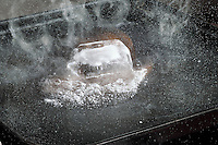 ICE MELTS & VAPORIZES QUICKLY ON HOT GRIDDLE<br /> (Variations Available)<br /> Three States of Matter - Ice, Water & Vapor<br /> 720 cal/gram is needed to first melt the solid, then vaporize the liquid water. The energy is absorbed by individual molecules of water to break the H bonds holding the crystal together resulting in a liquid then a gas.