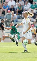 Melissa Tancredi (green) kicks the ball against Allison Faulk..Saint Louis Athletica and LA Sol played to a 0-0 tie at Robert Herman Stadium, St Louis, MO.