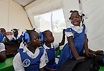 Students in class at the Notre Dame de Petits school in Port-au-Prince, Haiti. The school's building collapsed in the January 2010 earthquake, and while some classes are conducted in the ruins, other classes meet in large tents provided by International Orthodox Christian Charities.