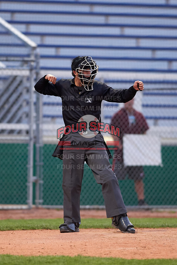 Home plate umpire Clay Williams calls a batter out on strikes during a Midwest League game between the Lake County Captains and Beloit Snappers at Pohlman Field on May 6, 2019 in Beloit, Wisconsin. Lake County defeated Beloit 9-1. (Zachary Lucy/Four Seam Images)