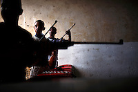 Young Cuban boys fire pellet guns at a shooting range in Havana, Cuba on 26 October 2008.