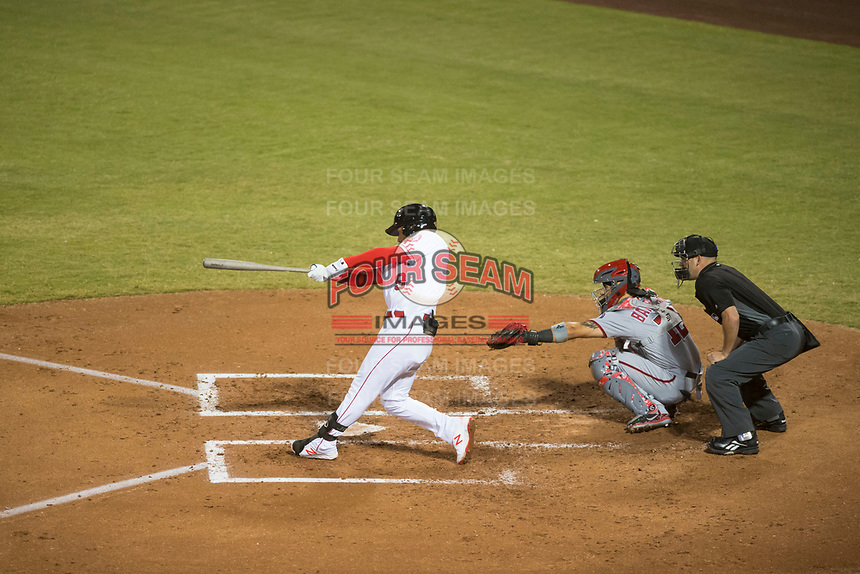 Mesa Solar Sox second baseman Jahmai Jones (9), of the Los Angeles Angels organization, swings at a pitch in front of catcher Tres Barrera (12) and home plate umpire Dan Merzel during an Arizona Fall League game against the Salt River Rafters at Sloan Park on October 16, 2018 in Mesa, Arizona. Salt River defeated Mesa 2-1. (Zachary Lucy/Four Seam Images)