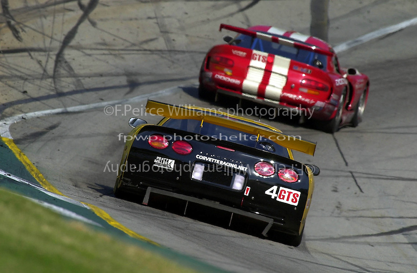 The eventual GTS winning Corvette of Pilgrim/ Collins/ Freon chases one of the Oreca Vipers down the hill and into turn 12..Petit Le Mans, Road Atlanta, Brazelton,GA,USA .30 September,2000  copyright©F.Peirce Williams 2000..
