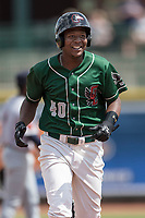 Great Lakes Loons outfielder Carlos Rincon (40) smiles as he runs around the bases against the Bowling Green Hot Rods during the Midwest League baseball game on June 4, 2017 at Dow Diamond in Midland, Michigan. Great Lakes defeated Bowling Green 11-0. (Andrew Woolley/Four Seam Images)