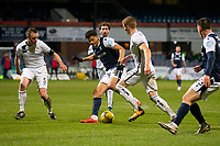 29th December 2020; Dens Park, Dundee, Scotland; Scottish Championship Football, Dundee FC versus Alloa Athletic; Osman Sow of Dundee twists and turns to try to get past Jon Robertson and Andy Graham of Alloa Athletic